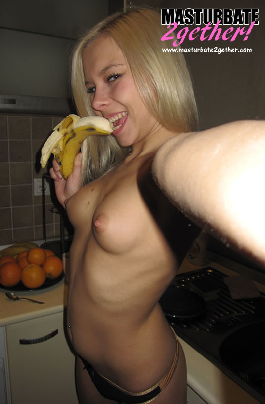 Cam girl eating a banana as if it work her fans hard dick.