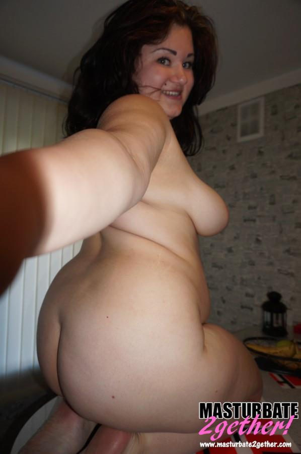 Gorgeous, curvaceous BBW takes a selfie capturing both her huge round ass and the soles of her feet.